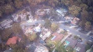 Houses destroyed -trees OK - aerial- 2